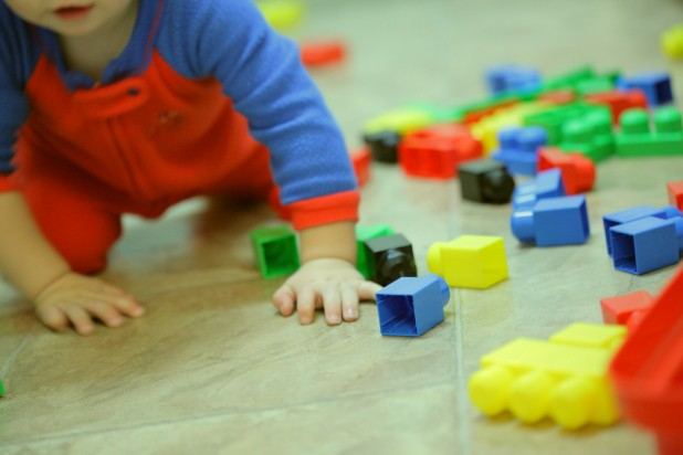 Generic Infant Child Playing With Building Bricks