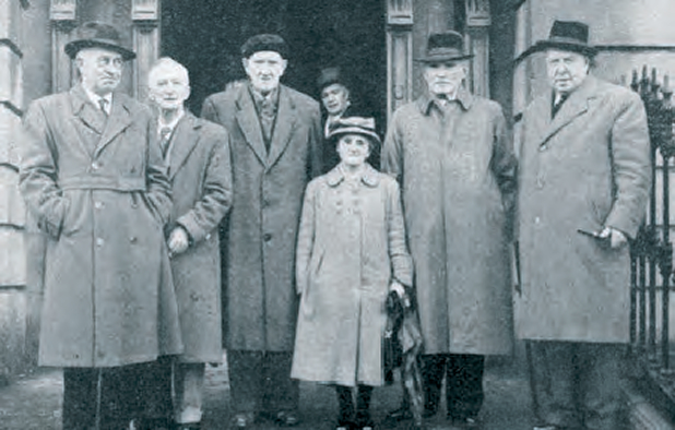 Rosie Hackett standing outside Liberty Hall, Dublin with Trade Unionists, 1950s