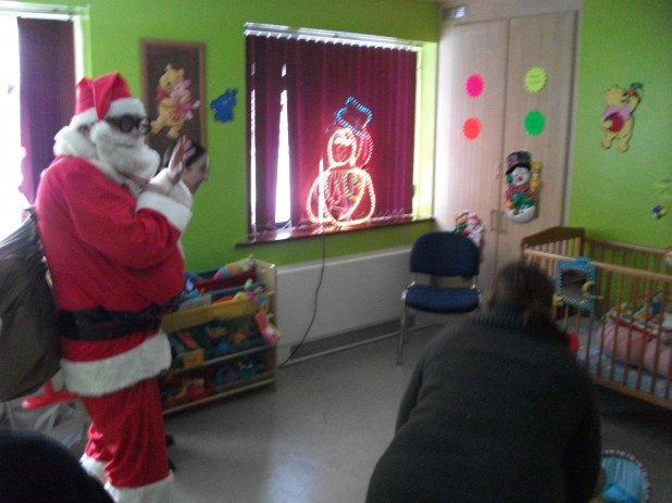 Santa Claus Visits The Wee Tots Creche on Basin Street in Dublin 8