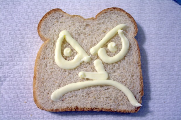 Angry Bread - slice of bread with angry face drawn on it with mayonnaise